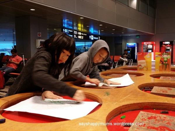 Crayon-rubbing at Changi Airport at 645AM