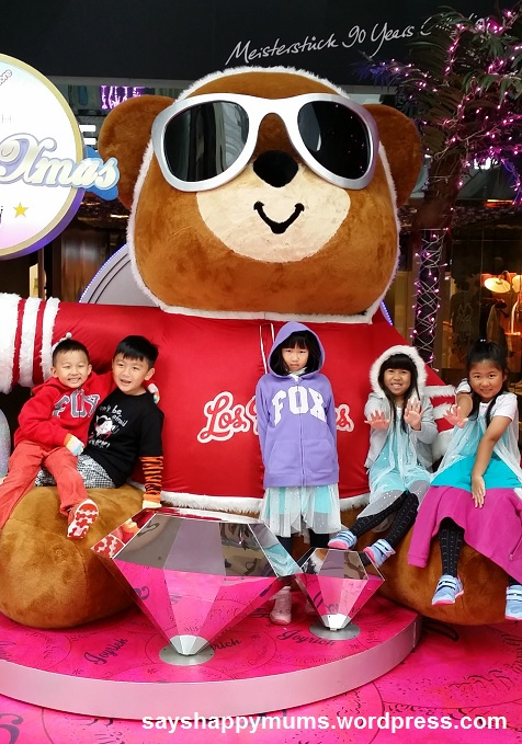 Day 3 and last day in HK City.  Fooling around with the giant teddy bear Christmas decor at a mall nearby our hotel.