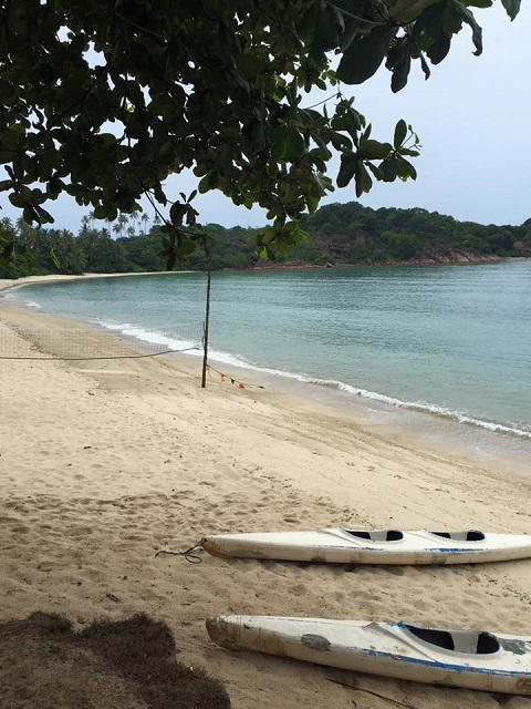 Beach on the left of resort - beach volley and kayak.