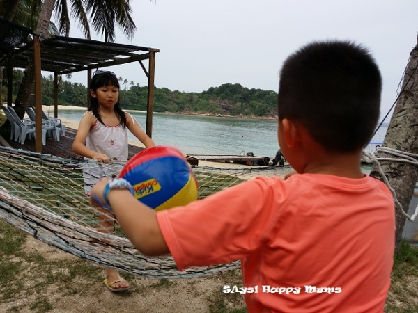 Outdoor time - improvised beach volley with the hammock as their net. hahahah